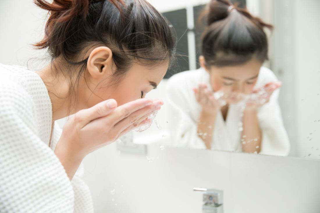 Washing the face after sweating may help to treat acne.