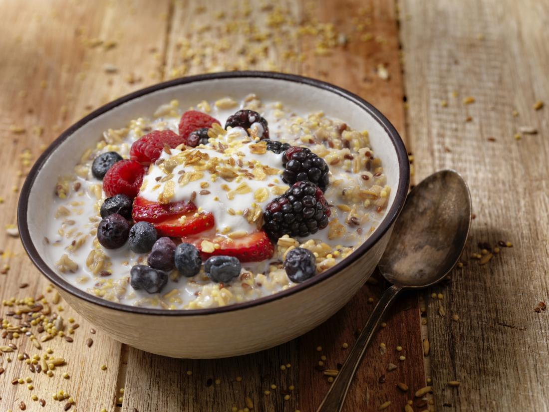 Cereal and yoghurt and berries in breakfast cereal.
