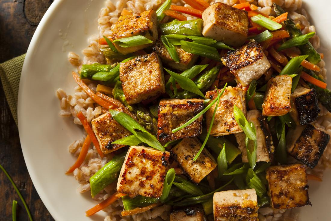 Tofu in bowl with rice.
