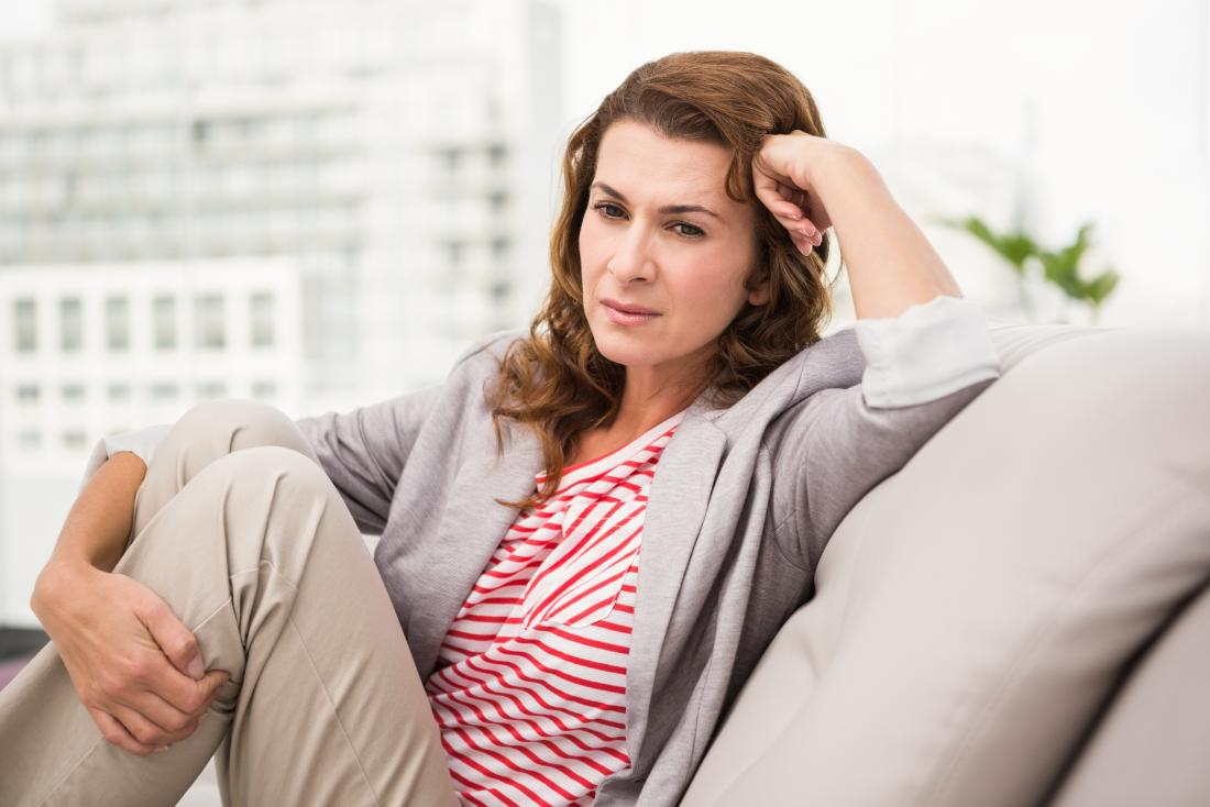 tired woman sitting on settee
