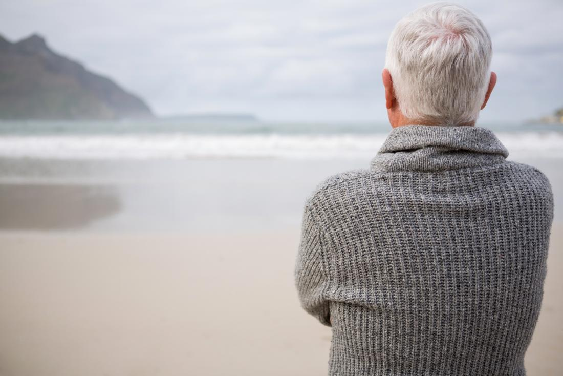 Older adult looking at the sea