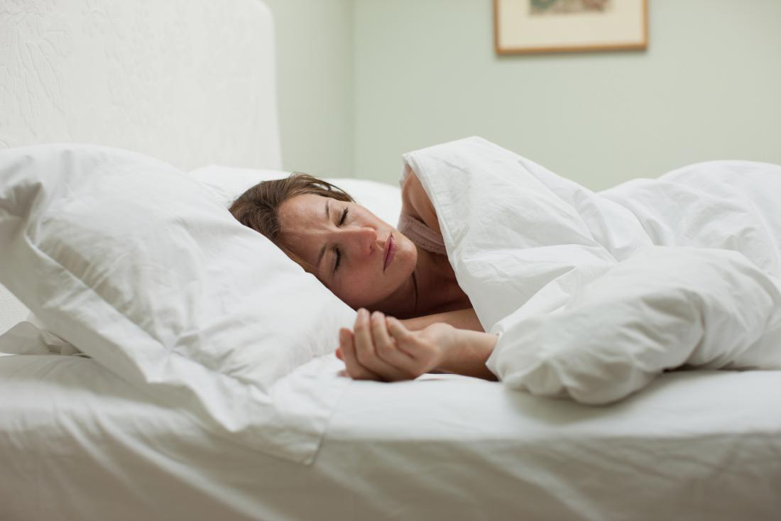 woman in bed due to viral pneumonia