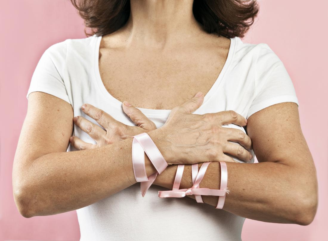 woman wearing breast cancer awareness ribbons