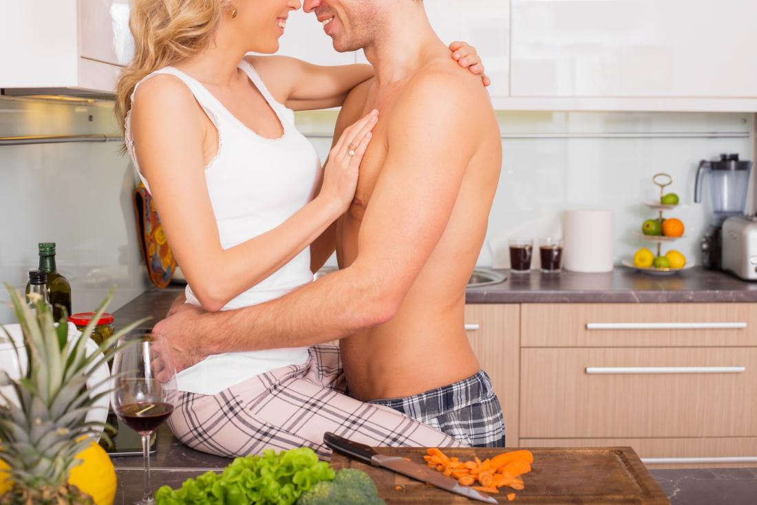 Man and woman in a kitchen wondering what are the best foods for sex