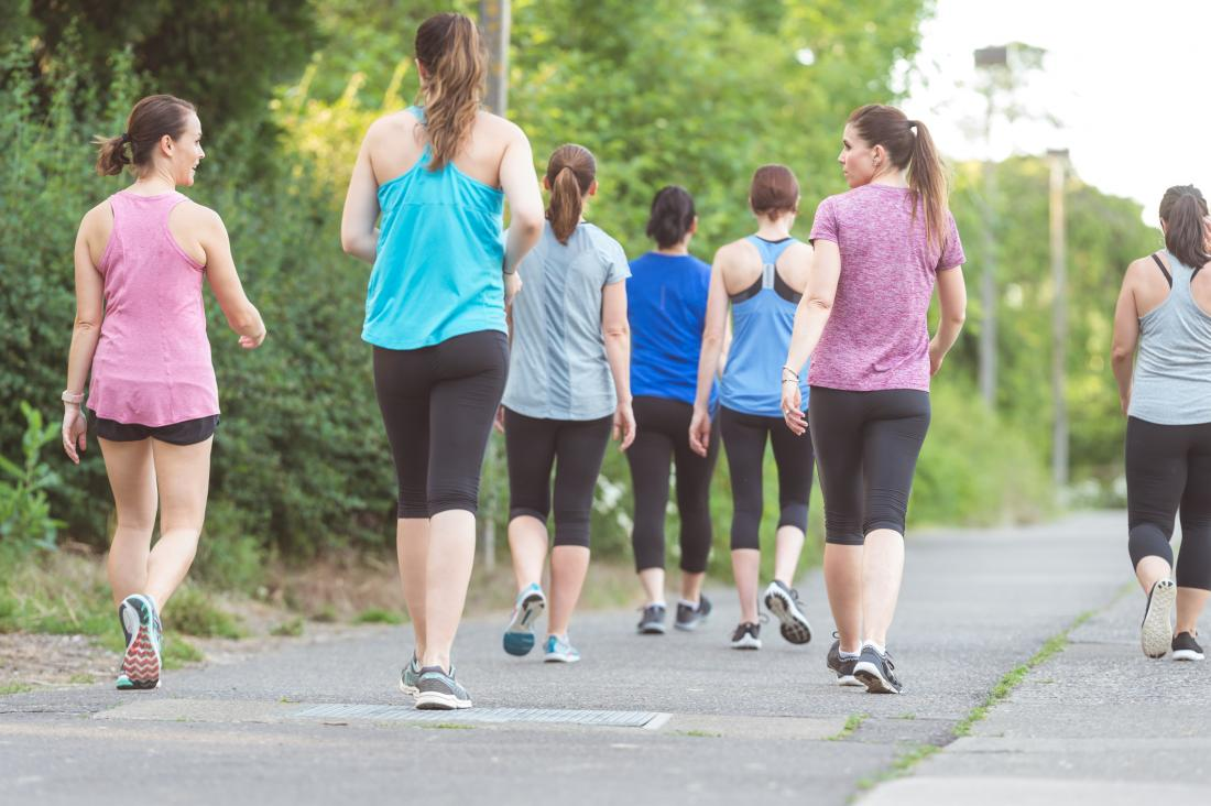 group of women brisk walking which is a stretch for runners