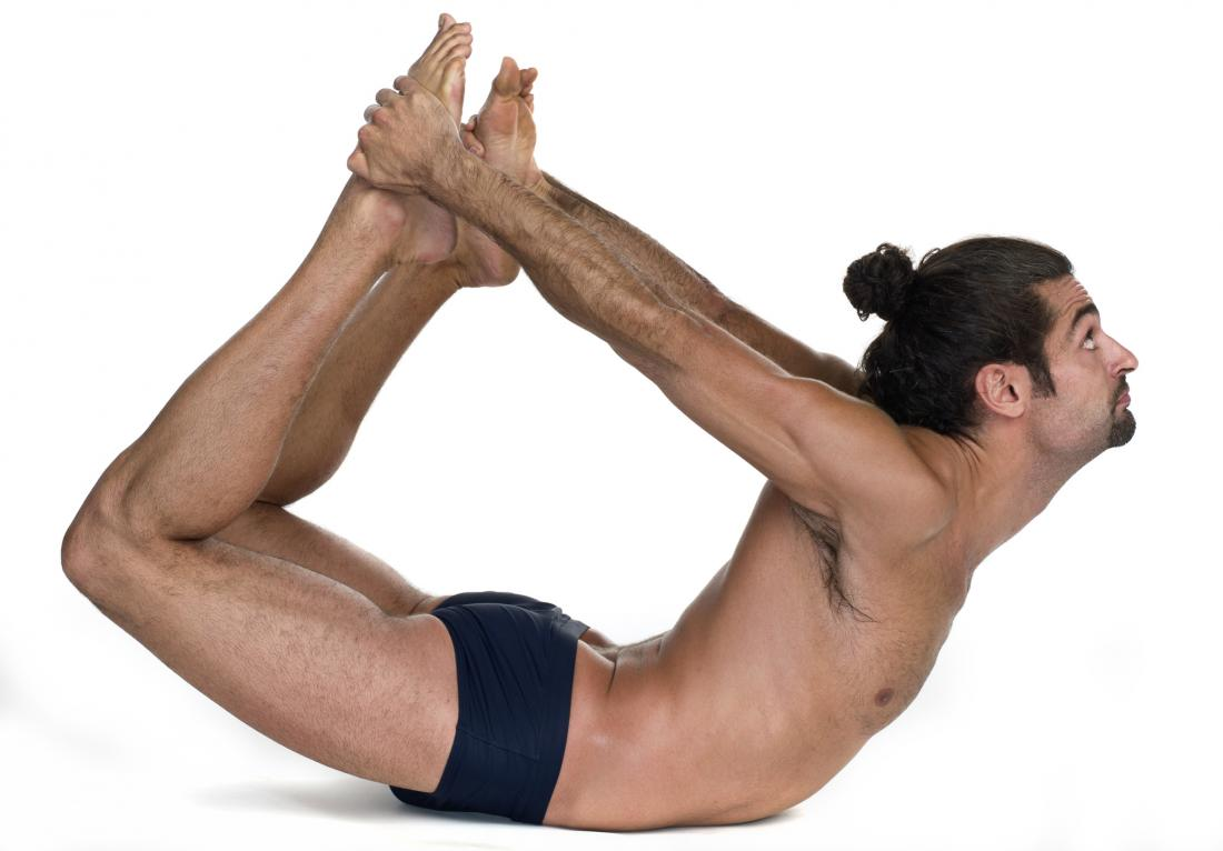 man doing bow pose