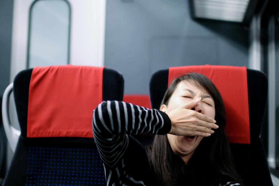 Tired woman on train