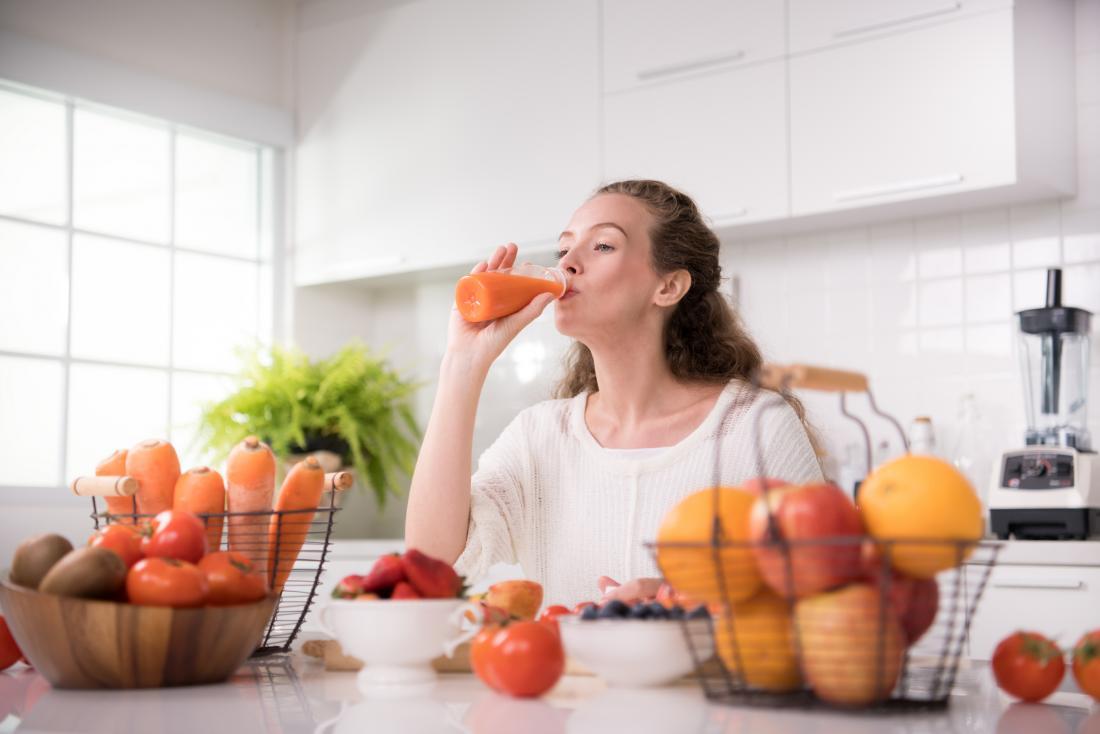 woman drinking fresh juice