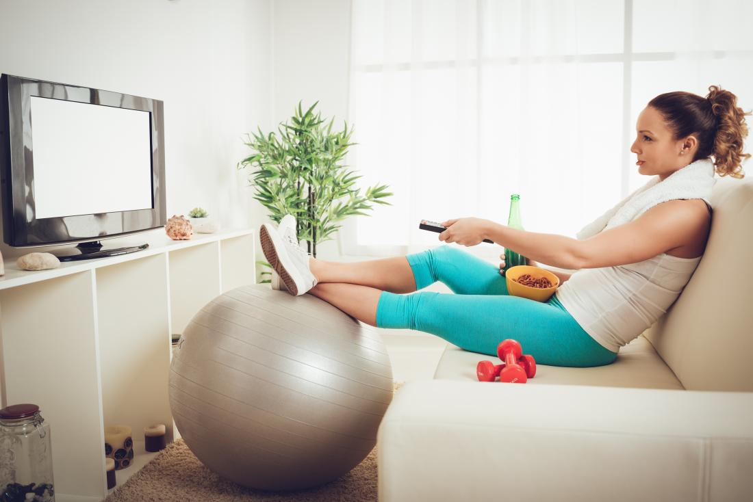 Woman sat on the sofa in exercise clothes