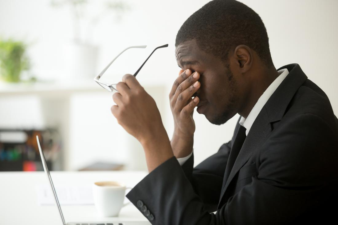 Man suffering from chronic stress at work
