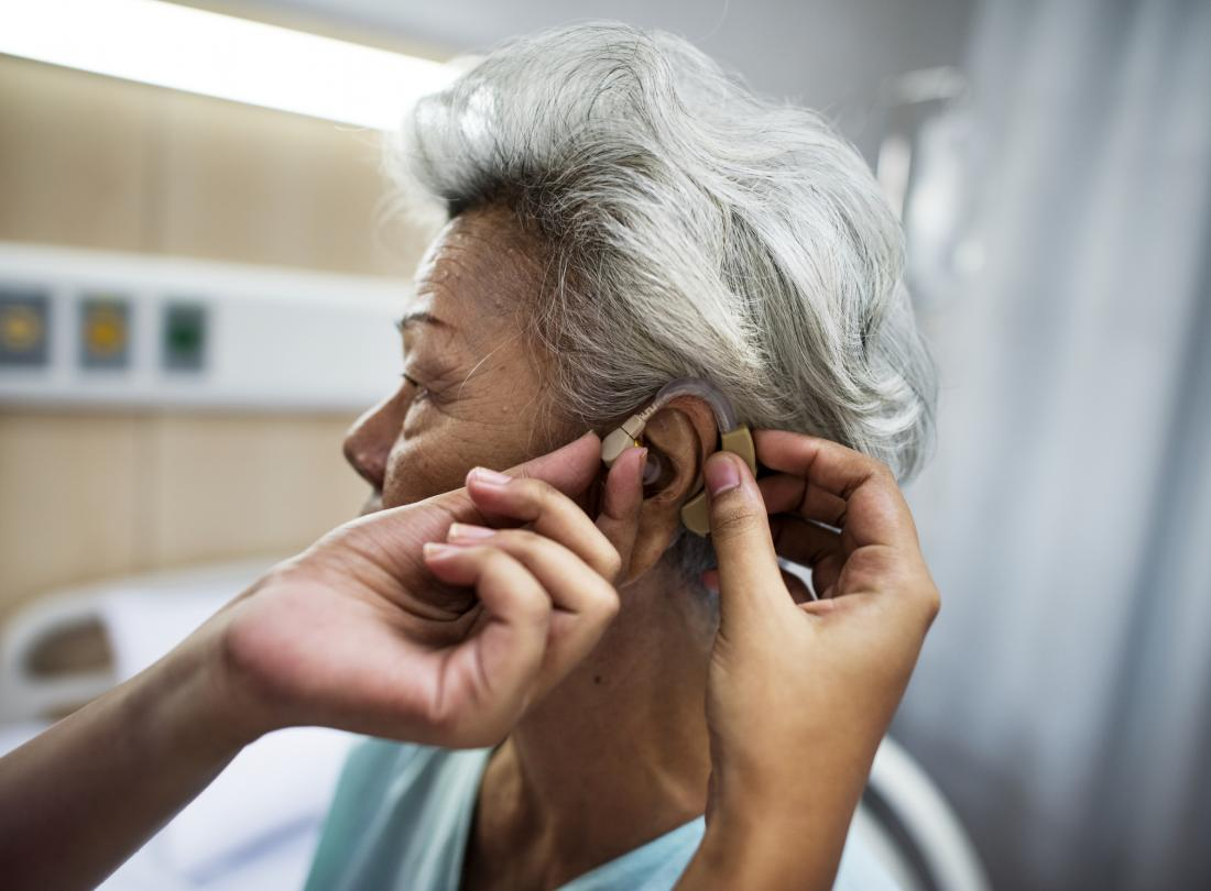 woman getting hearing aid fitted