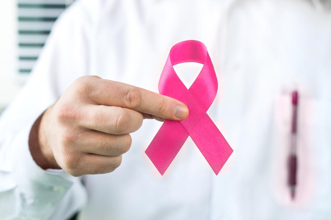 doctor holding breast cancer awareness ribbon