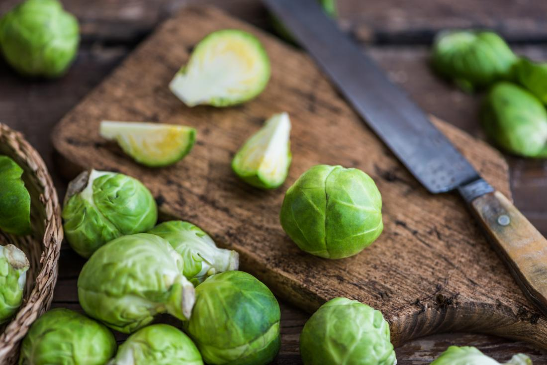 Brussels sprouts on chopping board