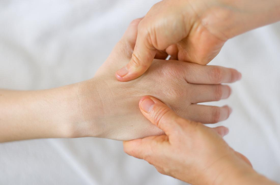person receiving acupressure massage which can help with neuropathy