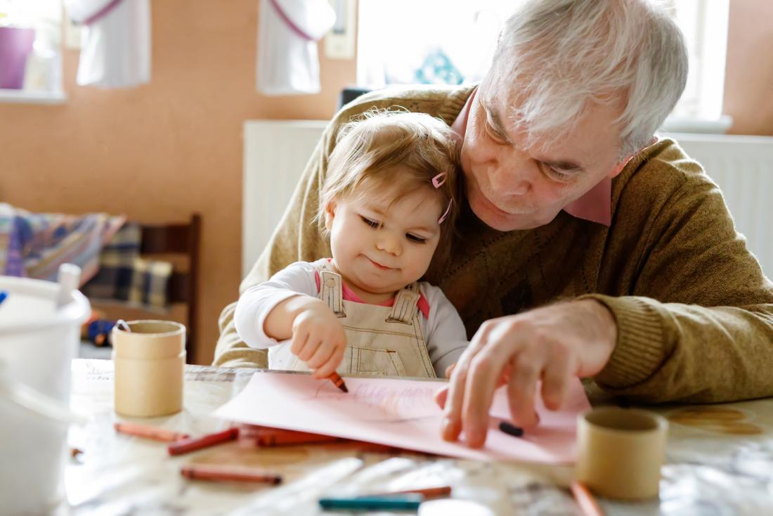 Grandparent with grandchild on lap drawing