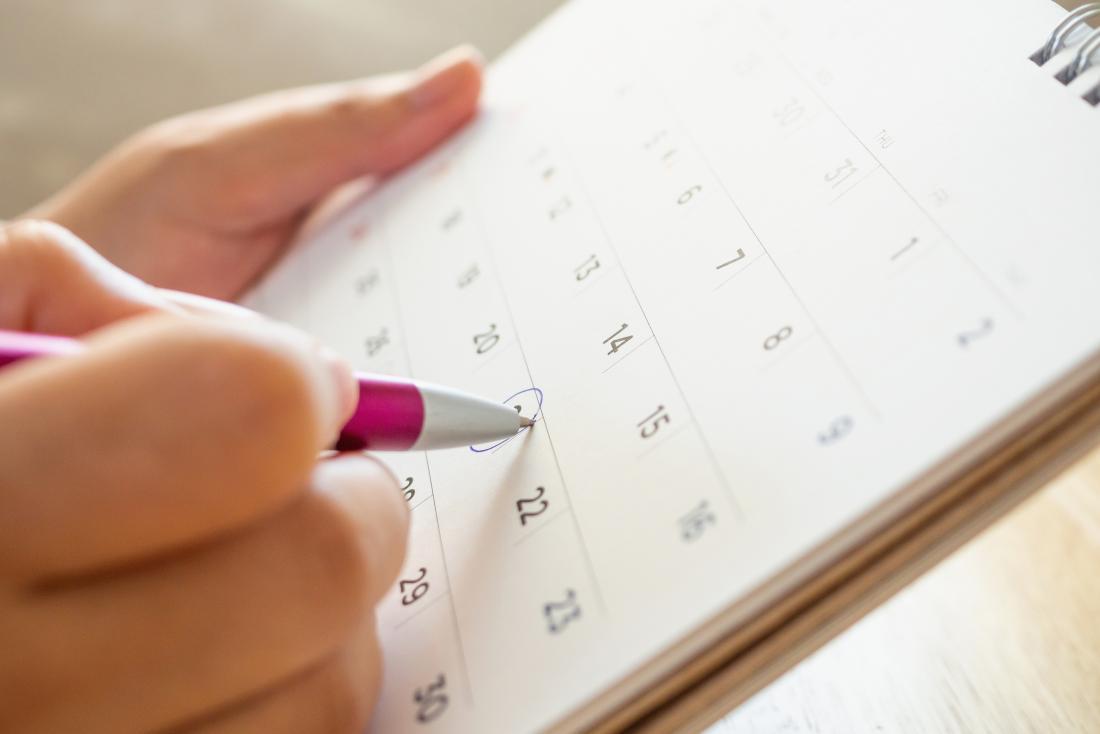 Woman checking a calendar to check for fertile discharge