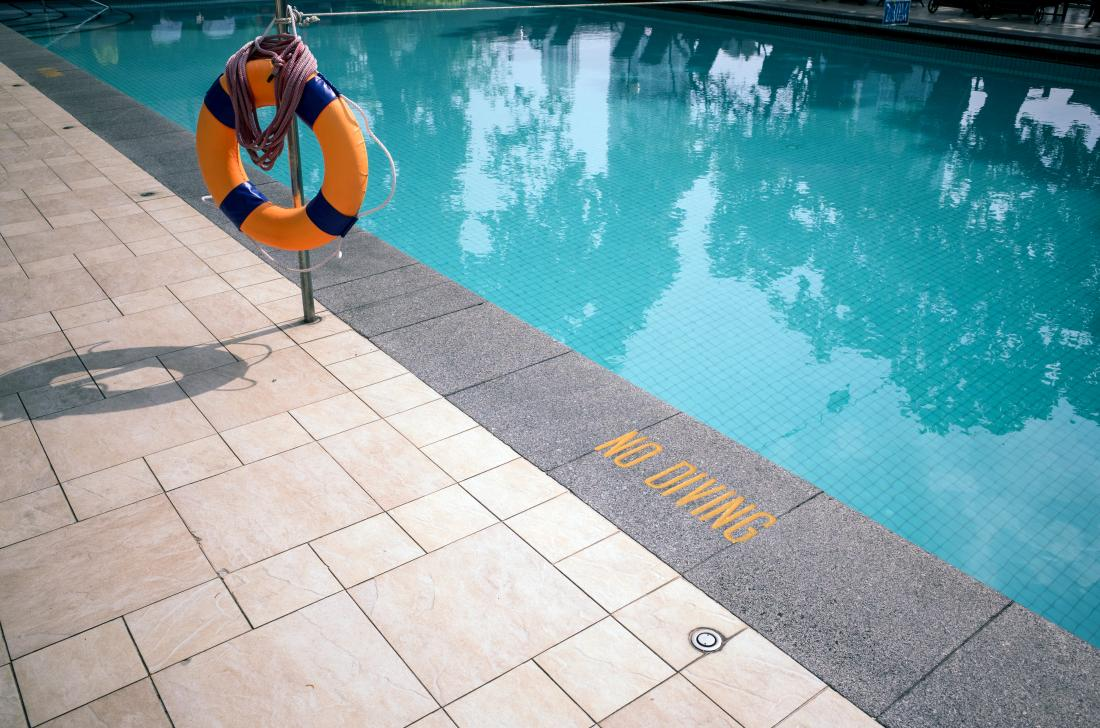Swimming pool with life float and no diving print
