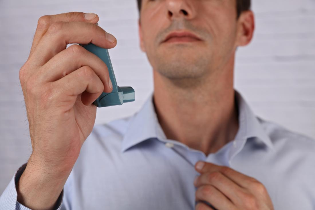 Man holding a bronchodilator for copd exacerbation treatment