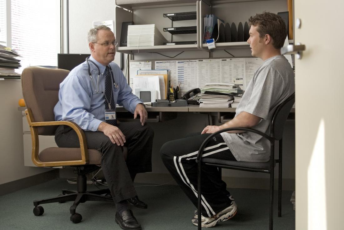 Doctor and patient in office discussing adrenal cancer