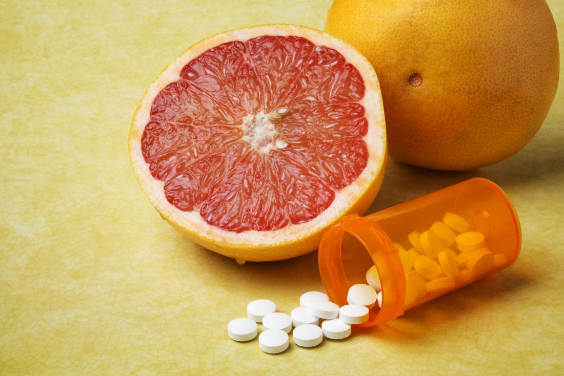grapefruit and prescription medication spilling from container