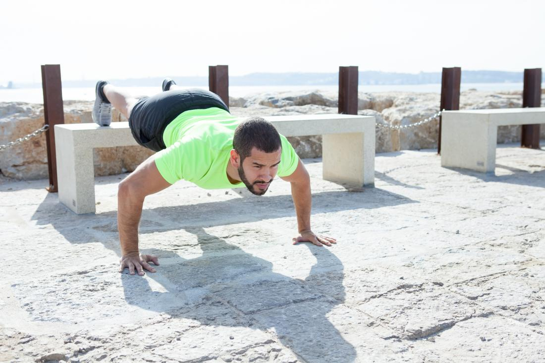 Man doing elevated pushups outdoors