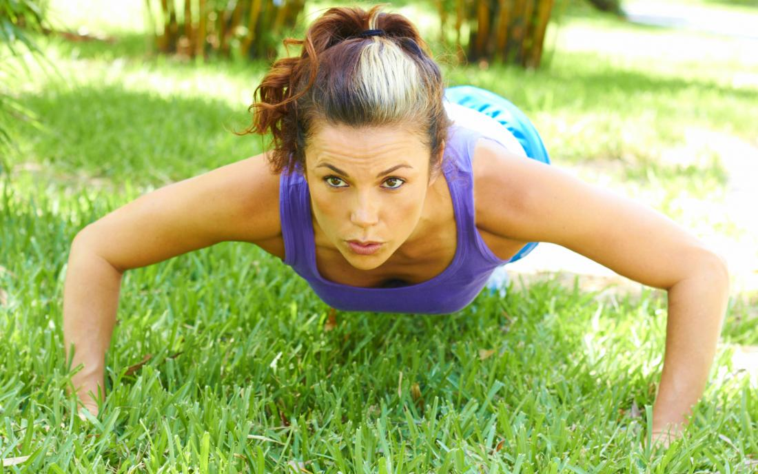 Woman doing wide pushups