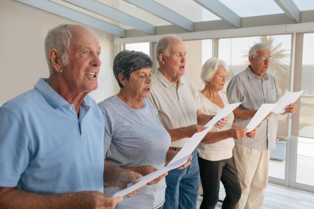 Older adults singing in a choir