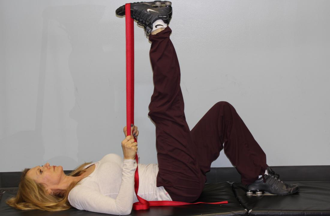 Lying hamstring stretch using strap. Image credit: bwanderd, 2012