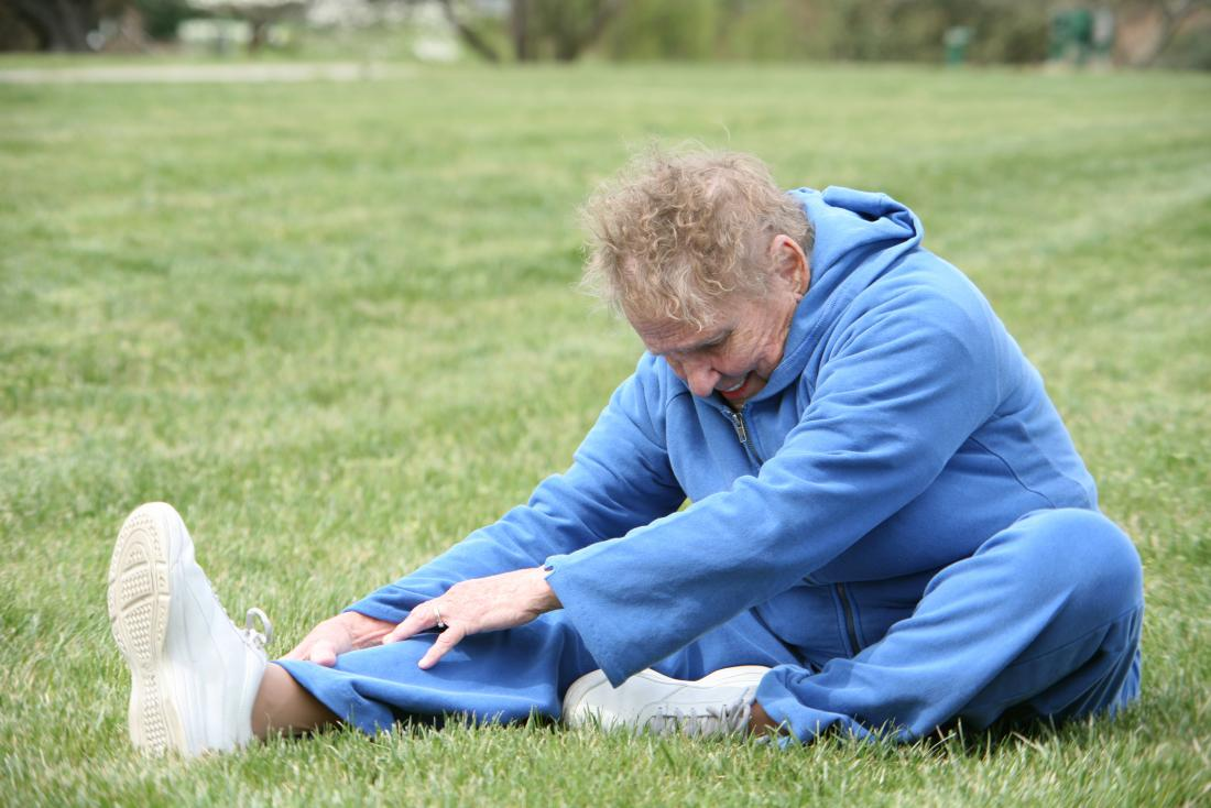 Senior woman doing hamstring stretches
