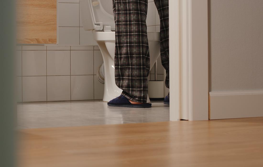 man standing in front of toilet