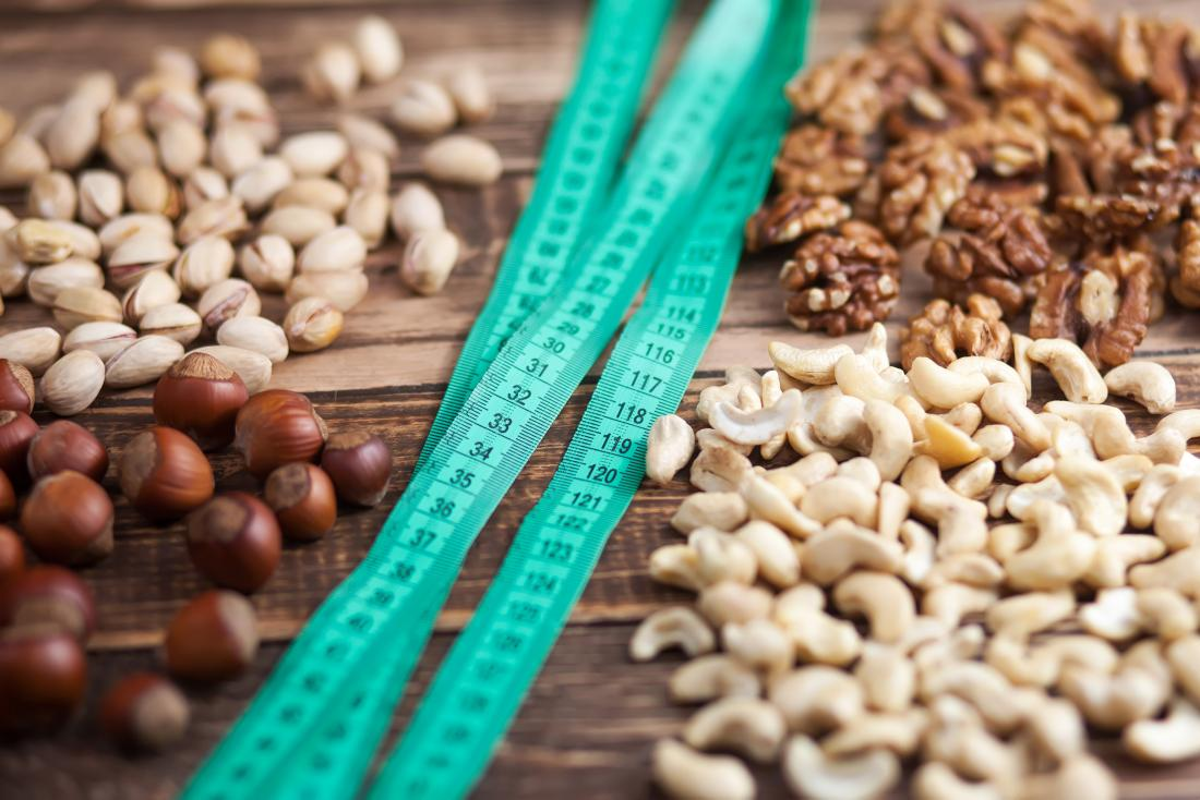 tape-measures and nuts on wooden table