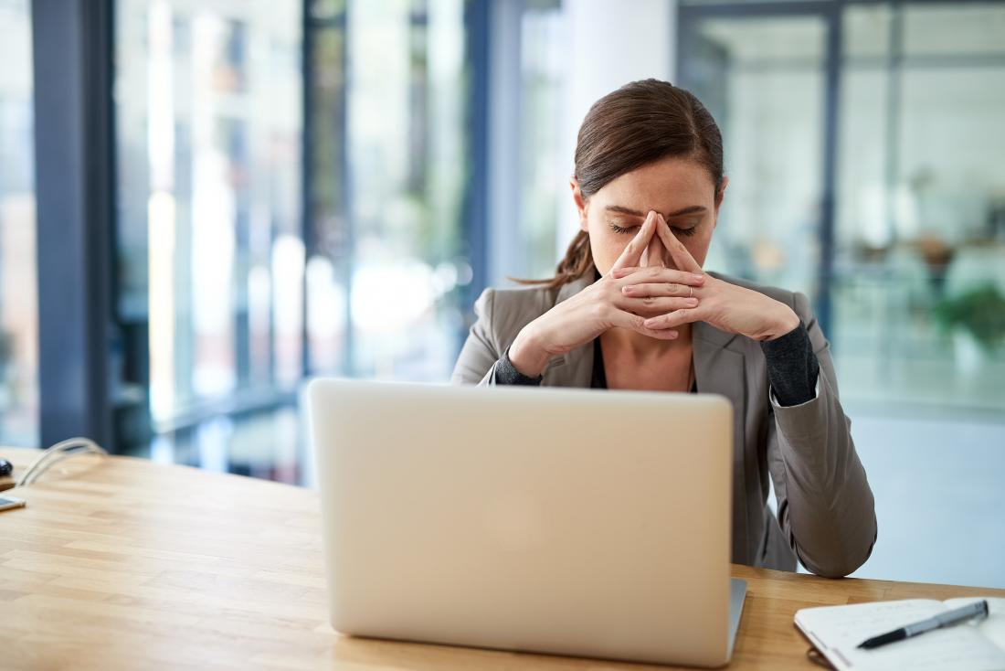 Woman at work with fatigue caused by autoimmune hepatitis