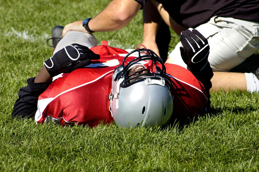 Football player with injured knee caused by lateral collateral ligament sprain