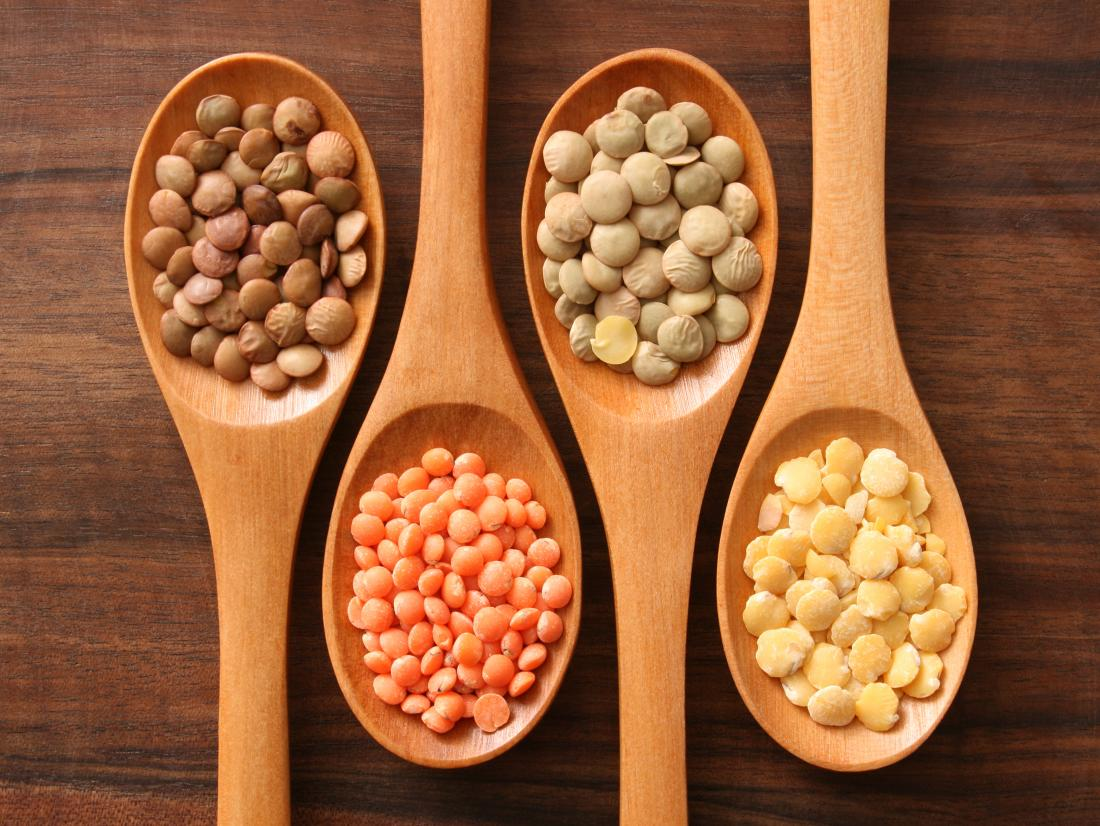 Different lentils on spoons which are iron-rich foods for vegetarians