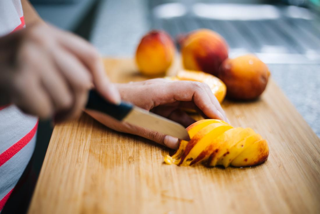 A peach being sliced which contains D mannose