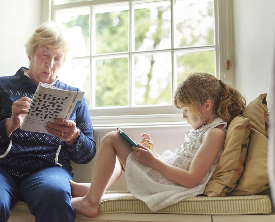 older woman and young girl solving puzzles