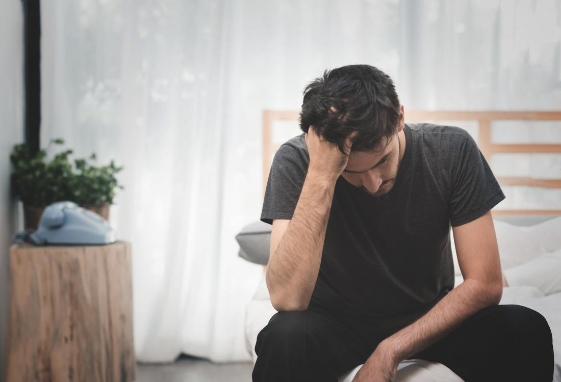 Erectile dysfunction - Impotence  man sat on the end of his bed worried about masturbation causing erectile dysfunction
