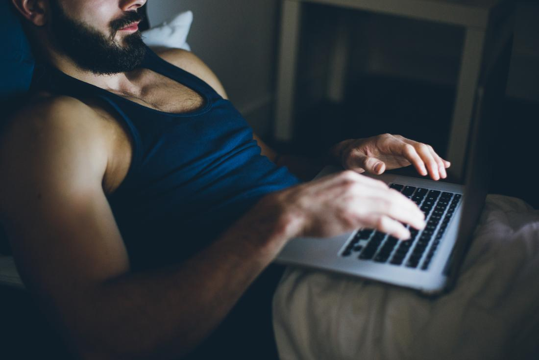 Erectile dysfunction - Impotence   Man using his laptop in bed
