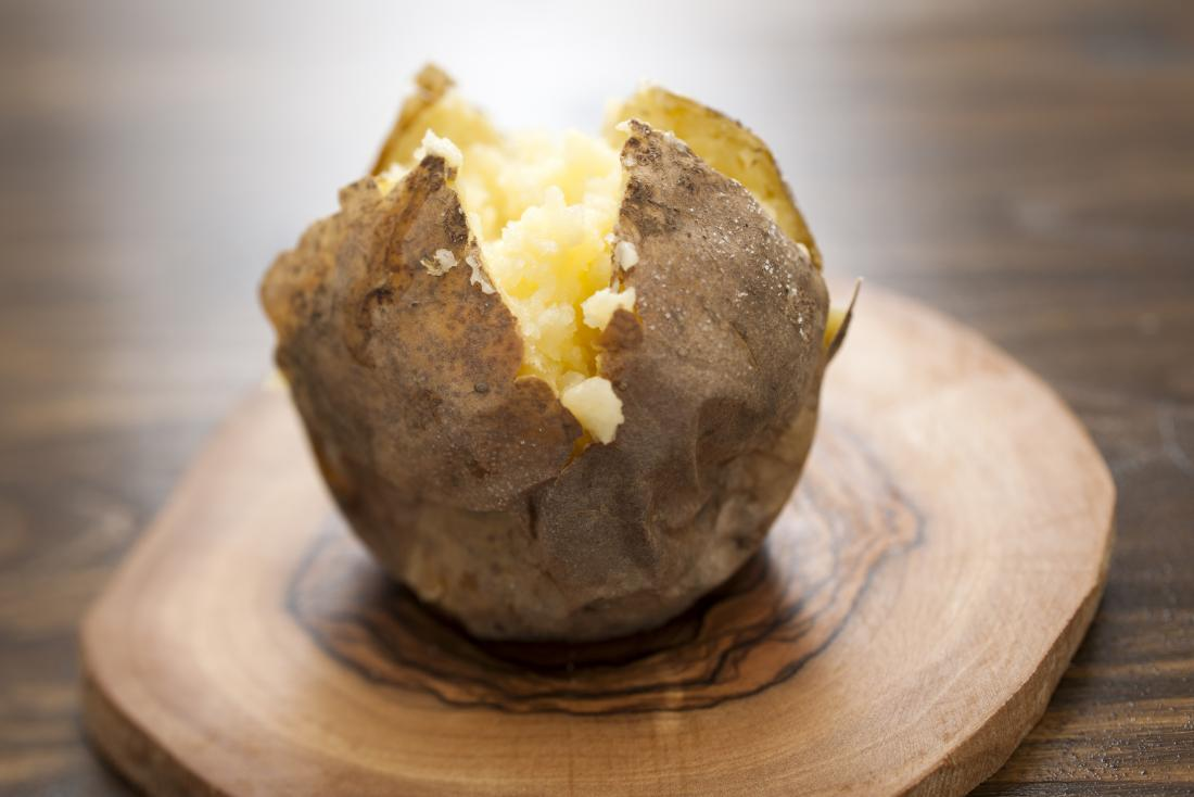 baked potato on a board which is a filling food