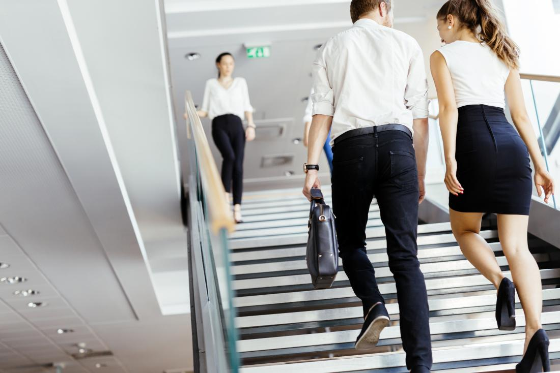office workers walking up stairs