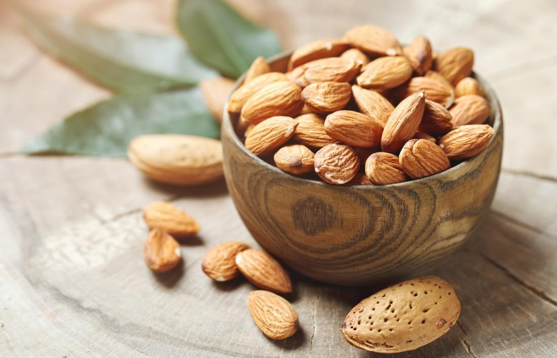 Almond nuts in a wooden bowl