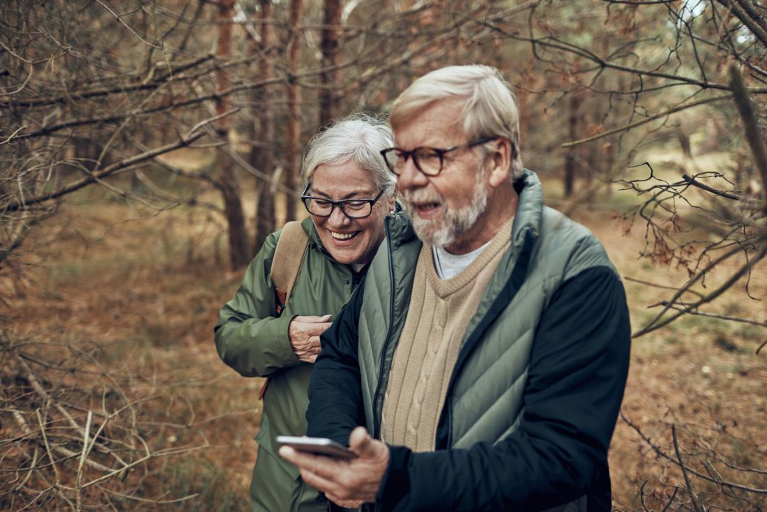 an older couple in the woods