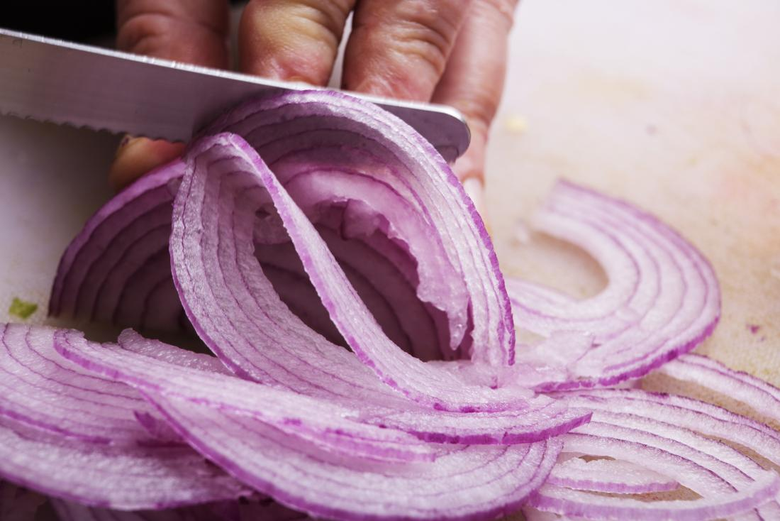 Red onion being cut<!--mce:protected %0A-->