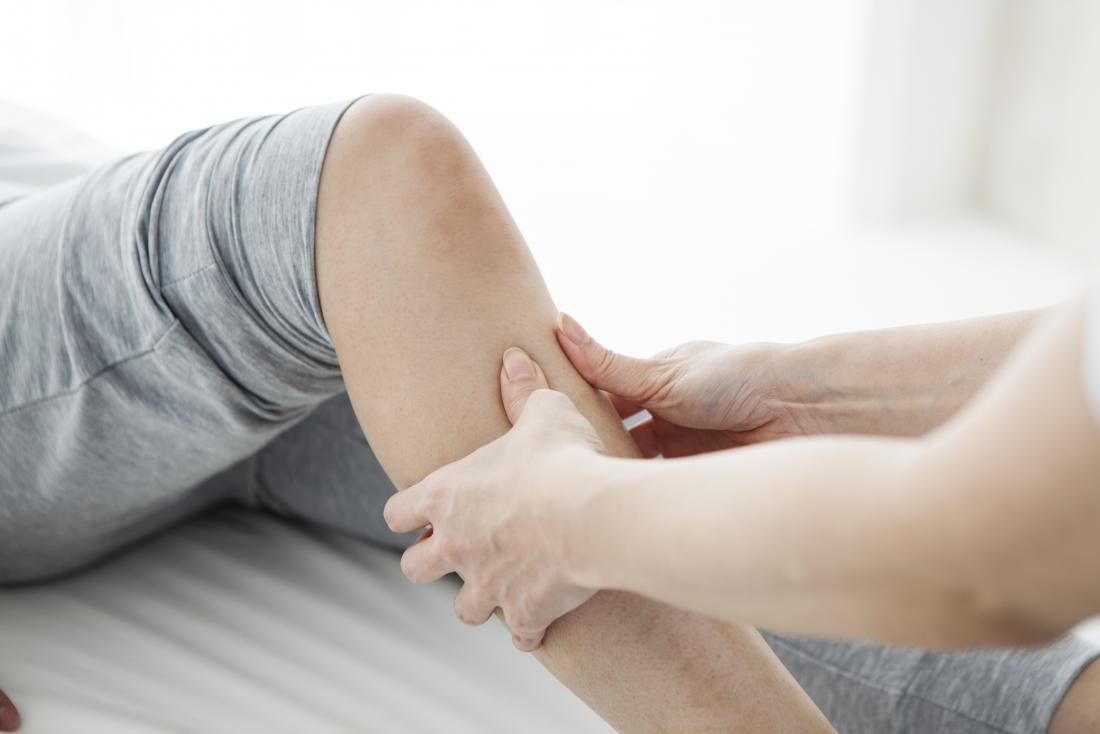 Person having leg massage to treat MS pain.
