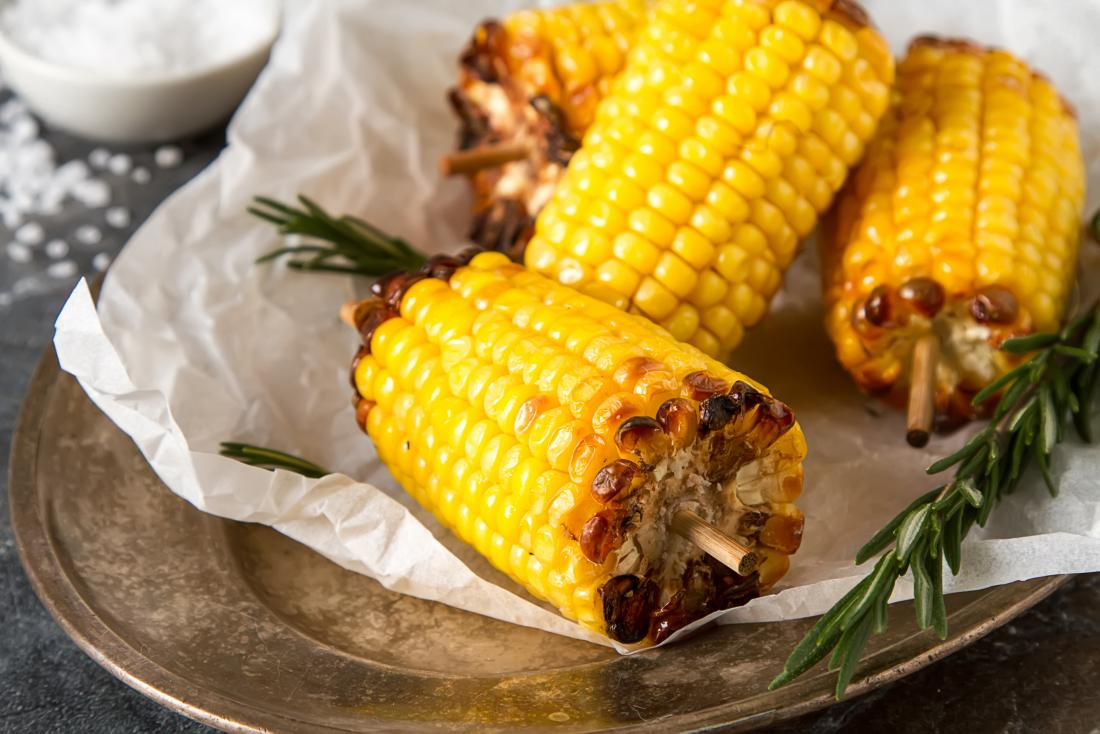 Corn on the cob on plate.
