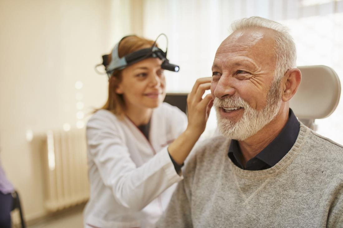 senior man having hearing test