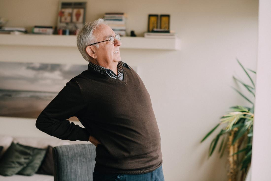 Senior man experiencing back pain