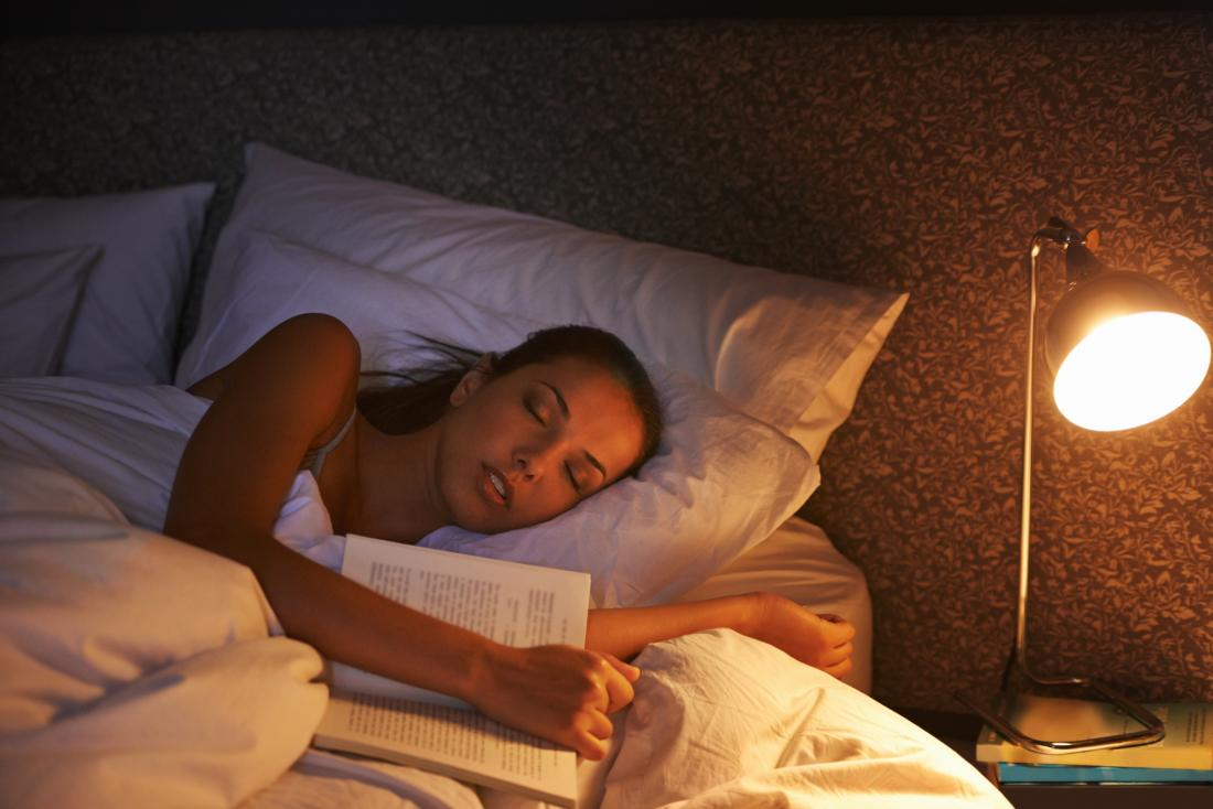 woman asleep with book