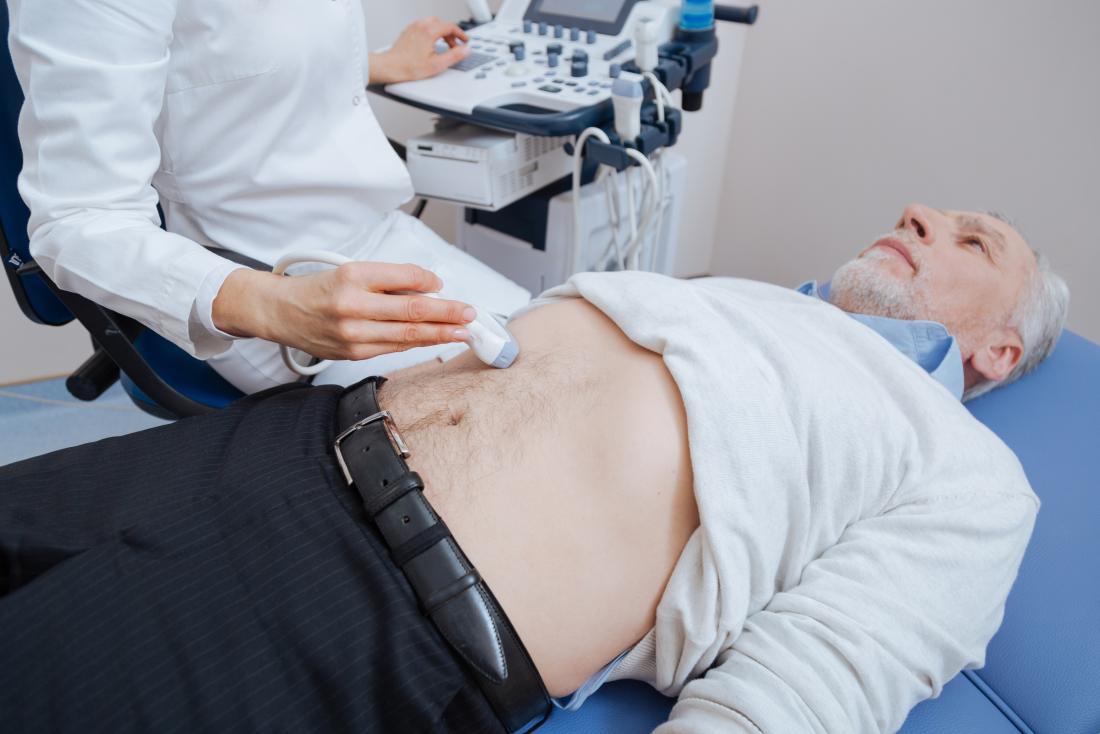 Man having abdominal ultrasound