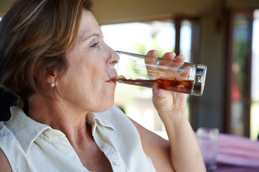 senior woman drinking coke